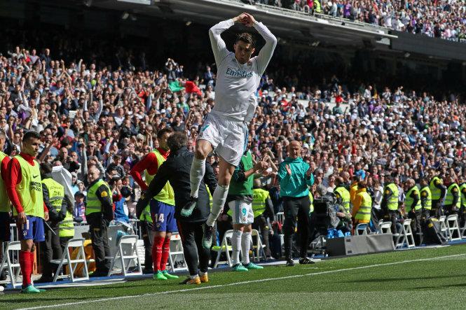 Ronaldo ăn mừng bàn mở tỉ số cho Real. Ảnh: Reutes