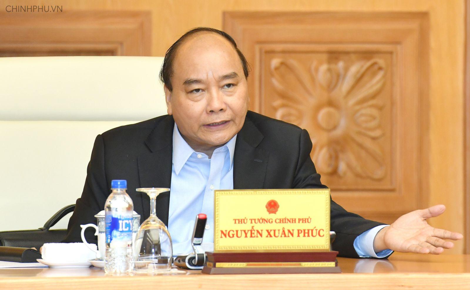 Thủ tướng Nguyễn Xuân Phúc chủ trì phiên họp Thường trực Chính phủ thảo luận về dự thảo Nghị quyết 01 của Chính phủ. Ảnh: VGP/Quang Hiếu
