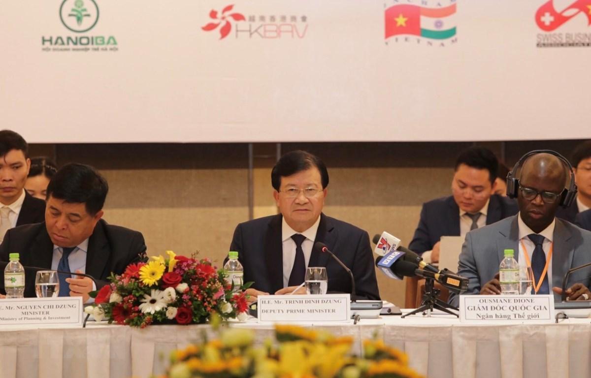 Phó Thủ tướng Chính phủ Trịnh Đình Dũng phát biểu chỉ đạo diễn đàn. (Ảnh: Trần Việt/TTXVN)