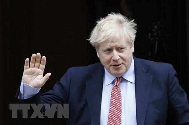 Thủ tướng Anh Boris Johnson sau cuộc họp tại nhà số 10 Phố Downing ở London ngày 18-3-2020. Ảnh: AFP/TTXVN