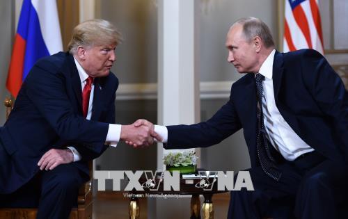 Tổng thống Nga Vladimir Putin (phải) và Tổng thống Mỹ Donald Trump. Ảnh tư liệu: AFP/TTXVN