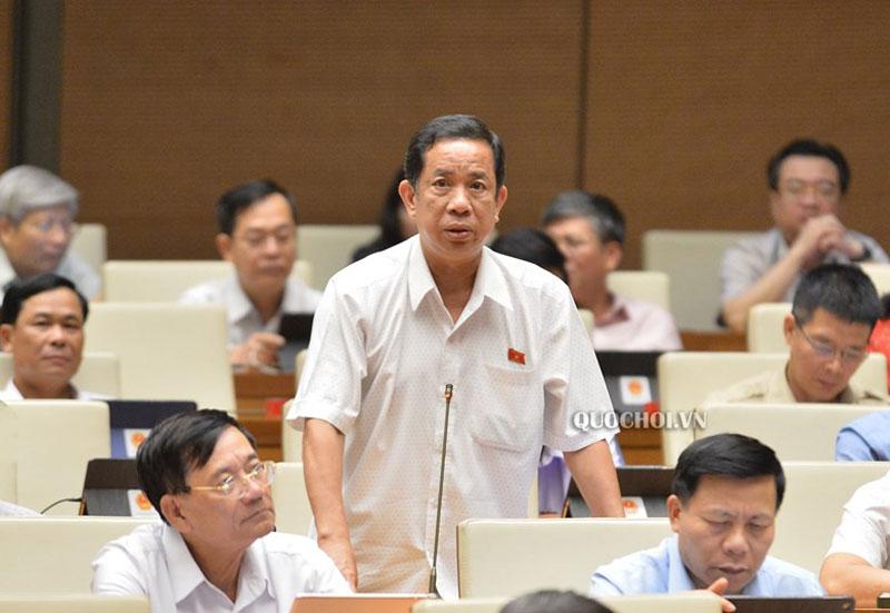 Đại biểu Đặng Thuần Phong - Phó chủ nhiệm Ủy ban về Các vấn đề xã hội của QH phát biểu tại Hội trường. Ảnh: Văn phòng QH