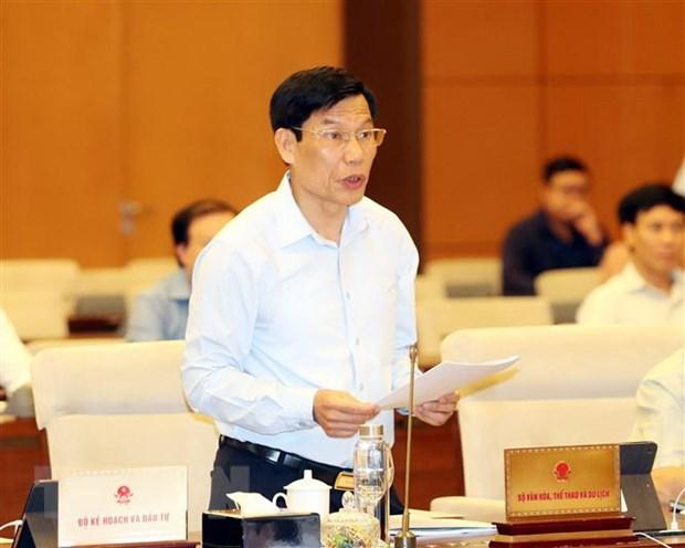 Bộ trưởng Bộ Văn hóa, Thể thao và Du lịch Nguyễn Ngọc Thiện trình bày Tờ trình. Ảnh: Trọng Đức/TTXVN