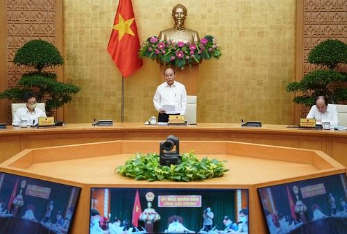Thủ tướng Nguyễn Xuân Phúc chủ trì Hội nghị. Ảnh: VGP/Quang Hiếu