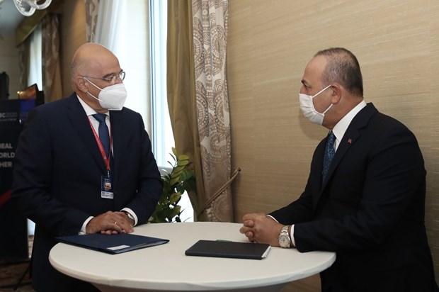 Ngoại trưởng Thổ Nhĩ Kỳ Mevlut Cavusoglu và người đồng cấp Hy Lạp Nikos Dendias gặp nhau bên lề Diễn đàn An ninh toàn cầu. (Nguồn: AA)
