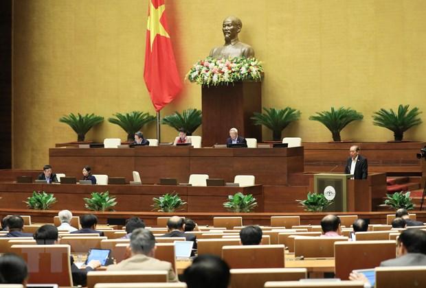 Phó Thủ tướng Thường trực Trương Hòa Bình trình bày báo cáo của Chính phủ về công tác phòng ngừa, chống tội phạm và vi phạm pháp luật; công tác thi hành án và công tác phòng, chống tham nhũng năm 2020. (Ảnh: Lâm Khánh/TTXVN)