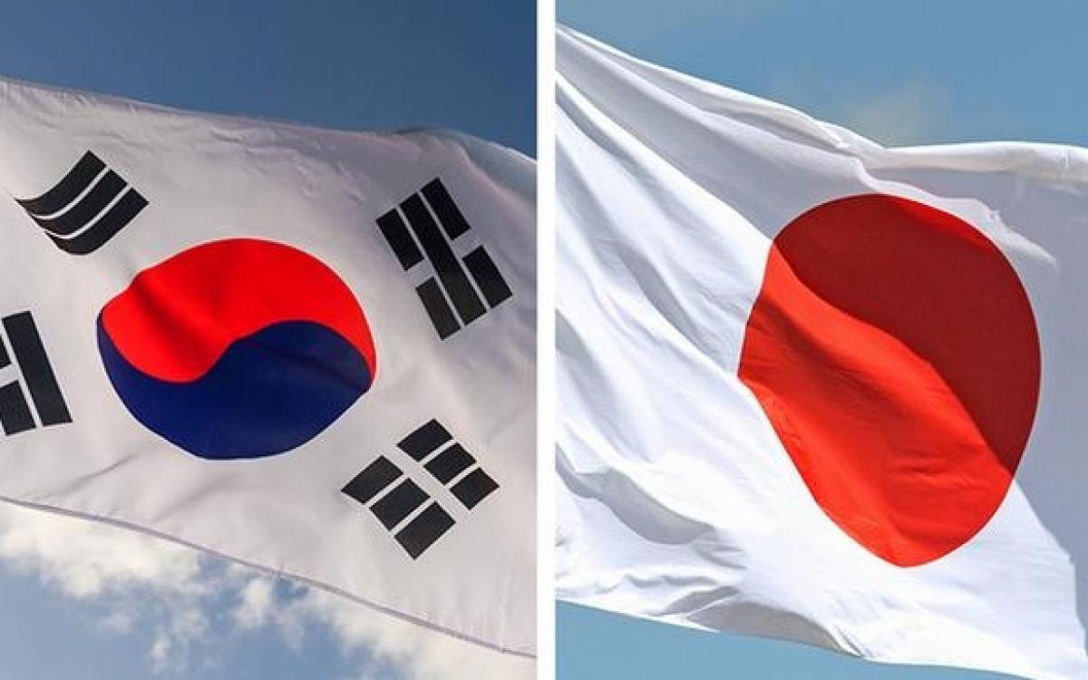 Cờ Nhật Bản và Hàn Quốc. Ảnh: DW.