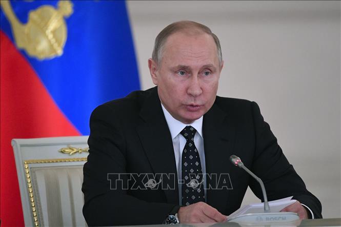 Tổng thống Nga Vladimir Putin chủ trì một cuộc họp tại Moskva, Nga. Ảnh: AFP/TTXVN