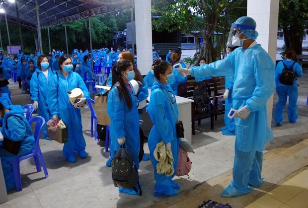 Cách ly công dân Việt Nam trở về từ nước ngoài. Ảnh: PV/Vietnam+
