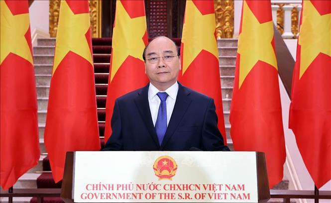 Thủ tướng Nguyễn Xuân Phúc có bài phát biểu chúc mừng Hội chợ Trung Quốc - ASEAN (CAEXPO) lần thứ 17. Ảnh: Thống Nhất/TTXVN