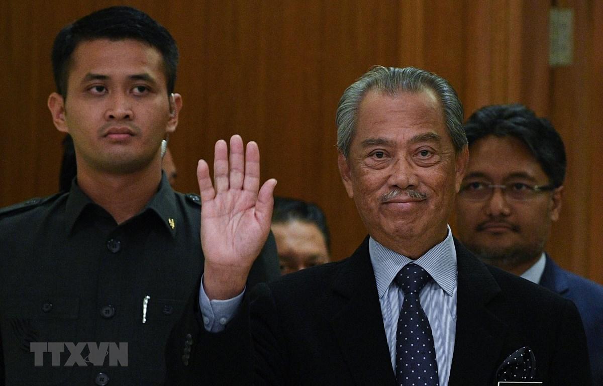 Thủ tướng Malaysia Muhyiddin Yassin (phải) tại một sự kiện ở Putrajaya ngày 9-3-2020. Ảnh: AFP/ TTXVN