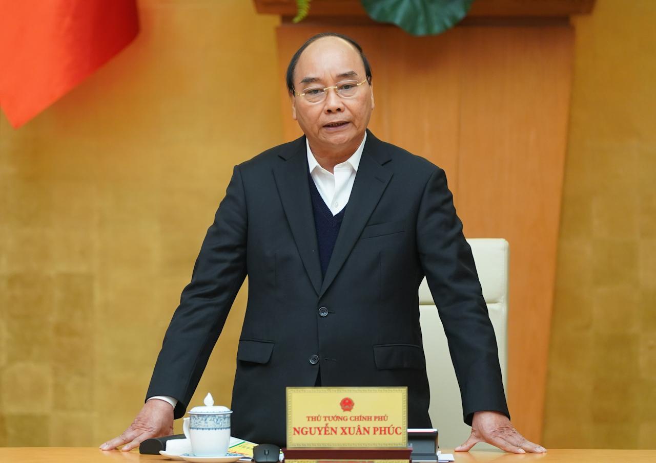 Thủ tướng Nguyễn Xuân Phúc: Tạm dừng các chuyến bay thương mại. Ảnh VGP/Quang Hiếu