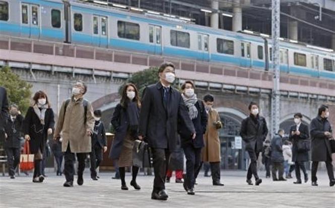 Người dân đeo khẩu trang phòng lây nhiễm COVID-19 tại Tokyo, Nhật Bản, ngày 7-1-2021. Ảnh: Kyodo/ TTXVN