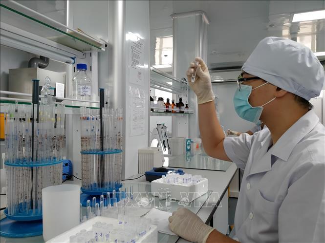 Việt Nam nỗ lực nghiên cứu, sản xuất vaccine COVID-19. Ảnh: TTXVN.