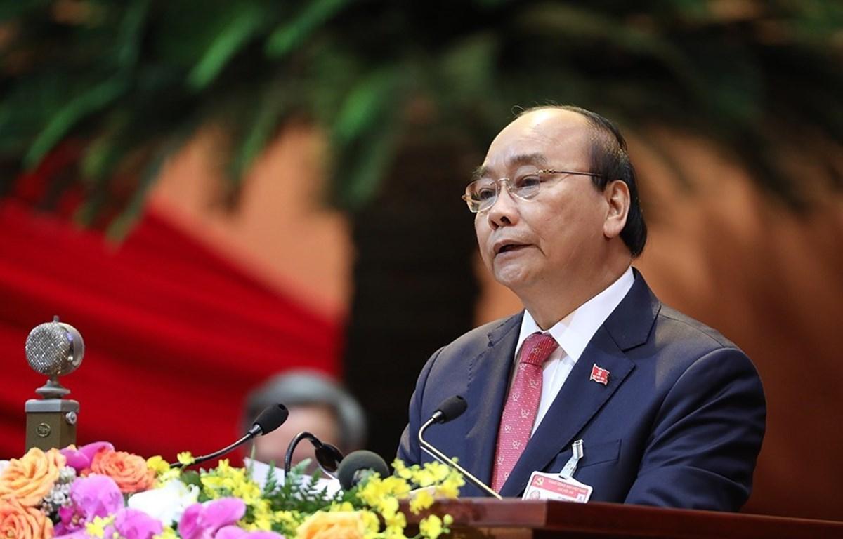 Ủy viên Bộ Chính trị, Thủ tướng Chính phủ Nguyễn Xuân Phúc thay mặt Đoàn Chủ tịch đọc Diễn văn khai mạc Đại hội. Ảnh: TTXVN