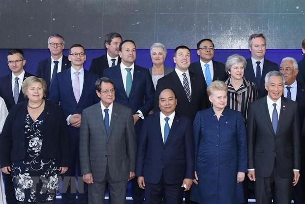 Thủ tướng Nguyễn Xuân Phúc và các trưởng đoàn chụp ảnh chung tại Phiên họp toàn thể thứ hai Hội nghị Cấp cao Á-Âu lần thứ 12 (ASEM 12), ngày 19-10-2018, tại Brussels (Bỉ). Ảnh: Thống Nhất/TTXVN