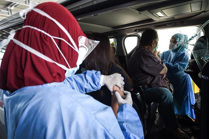 Một điểm tiêm chủng vaccine ngừa COVID-19 tại Jakarta, Indonesia, ngày 3-3-2021. Ảnh: AFP/TTXVN