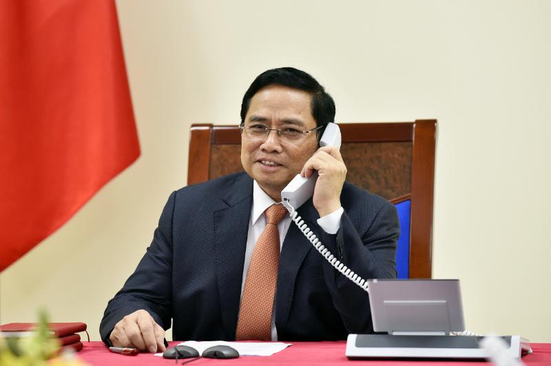 Thủ tướng Chính phủ Phạm Minh Chính điện đàm với Thủ tướng Singapore Lý Hiển Long - Ảnh: VGP/Nhật Bắc
