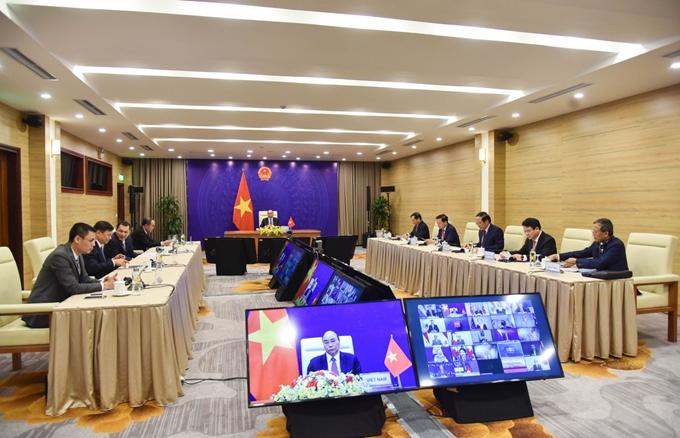Chủ tịch nước Nguyễn Xuân Phúc và Đoàn Việt Nam tham dự Phiên khai mạc Hội nghị thượng đỉnh về Khí hậu