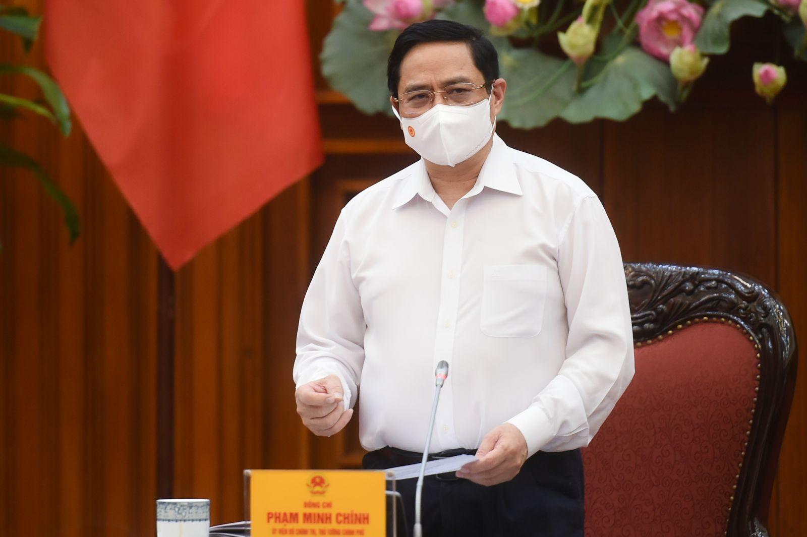 Thủ tướng Phạm Minh Chính chủ trì cuộc họp Thường trực Chính phủ về phòng, chống dịch COVID-19 diễn ra sáng 26-4-2021. Ảnh VGP