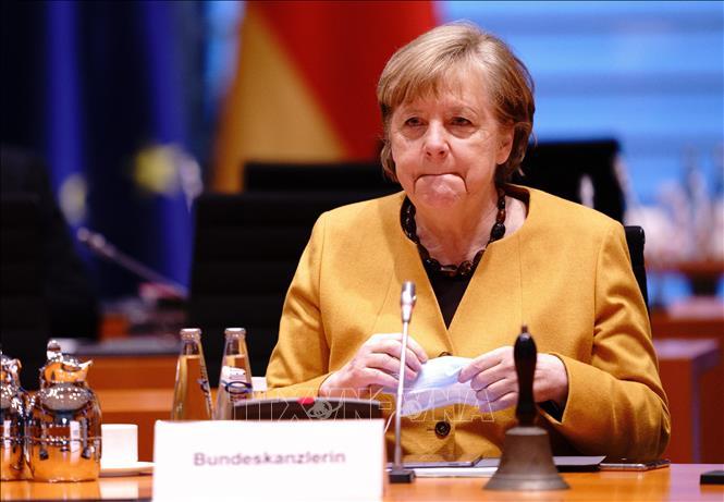 Thủ tướng Đức Angela Merkel tới cuộc họp nội các tuần ở Berlin ngày 24-3-2021. Ảnh: AFP/TTXVN