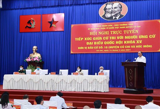 Hội nghị diễn ra theo hình thức trực tuyến tại 2 huyện Củ Chi và Hóc Môn. Ảnh: TTXVN