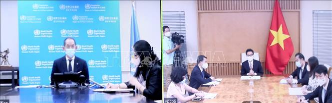 Phó thủ tướng Vũ Đức Đam tham dự họp trực tuyến với Tiến sĩ Takeshi Kasai, Giám đốc tổ chức Y tế thế giới (WHO) khu vực Tây Thái Bình Dương. Ảnh: Phạm Kiên/TTXVN