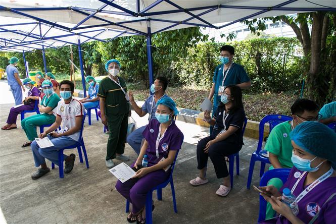 Một điểm tiêm vaccine ngừa COVID-19 tại Yangon, Myanmar ngày 27-1-2021. Ảnh: AFP/TTXVN