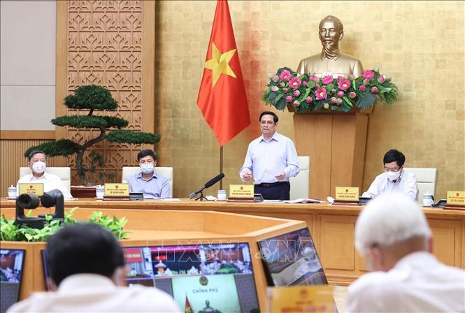 Thủ tướng Phạm Minh Chính chủ trì họp trực tuyến. Ảnh: Dương Giang/TTXVN