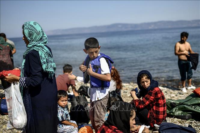 Người di cư từ Afghanistan sau hành trình vượt biển Aegean tới đảo Lesbos, Hy Lạp, ngày 6-8-2018. Ảnh: AFP/TTXVN
