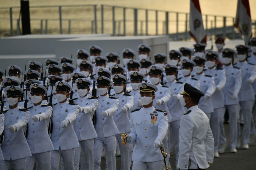 Khoảng 600 người đã đeo khẩu trang tham gia cuộc diễu hành. Ảnh: Straits Times