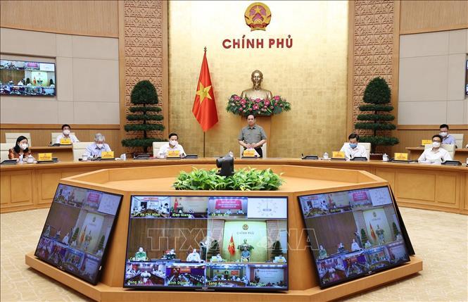 Thủ tướng Phạm Minh Chính chủ trì cuộc họp Ban chỉ đạo Quốc gia phòng, chống dịch COVID-19 với các địa phương. Ảnh: Dương Giang/TTXVN