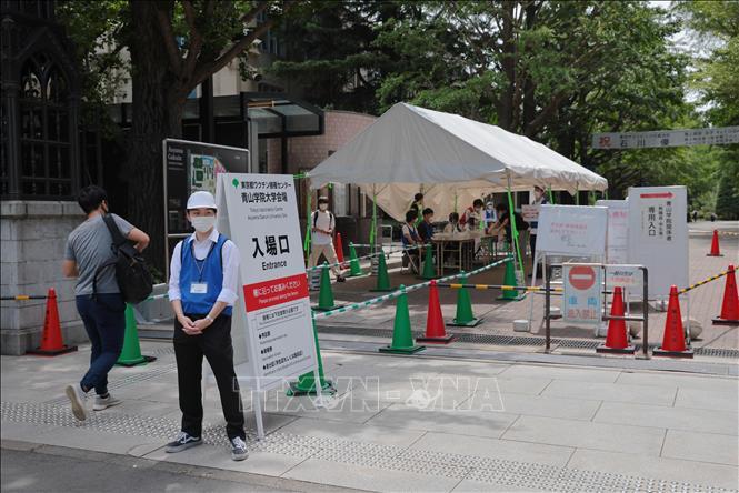 Một điểm tiêm chủng vaccine COVID-19 tại Tokyo, Nhật Bản. Ảnh: AFP/TTXVN