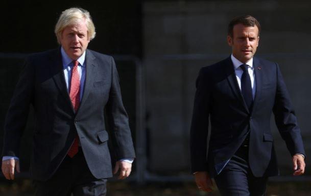 Tổng thống Emmanuel Macron và Thủ tướng Anh Boris Johnson. (Nguồn: Reuters)
