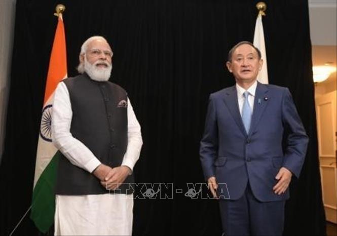Thủ tướng Nhật Bản Suga Yoshihide (phải) và Thủ tướng Ấn Độ Narendra Modi trong cuộc gặp tại Washington D.C., Mỹ, ngày 23-9-2021. Ảnh: Kyodo/TTXVN