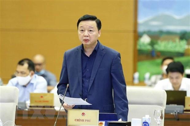 Bộ trưởng Bộ Tài nguyên và Môi trường Trần Hồng Hà trình bày Tờ trình. Ảnh Doãn Tấn/TTXVN